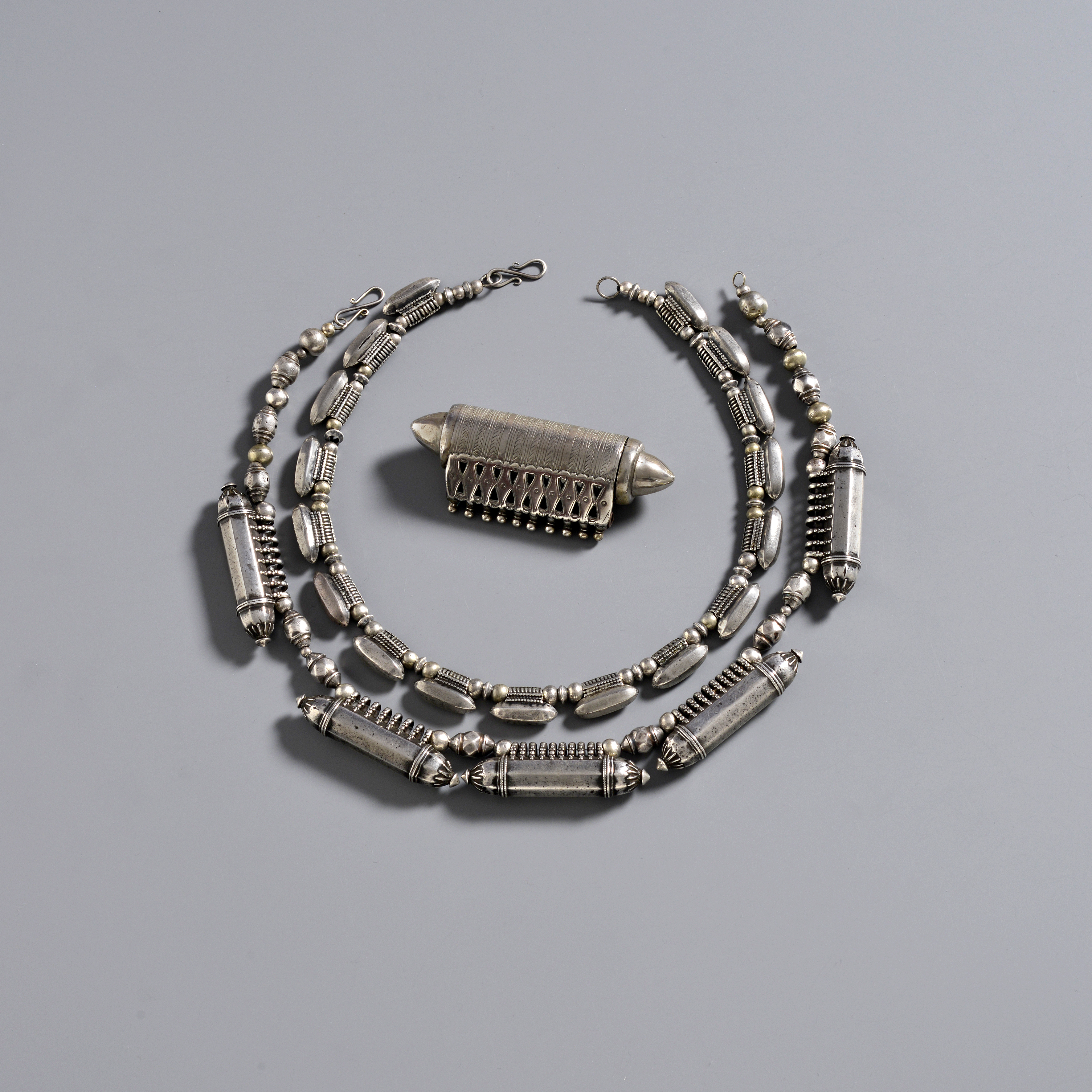 322. India, silver amulets.